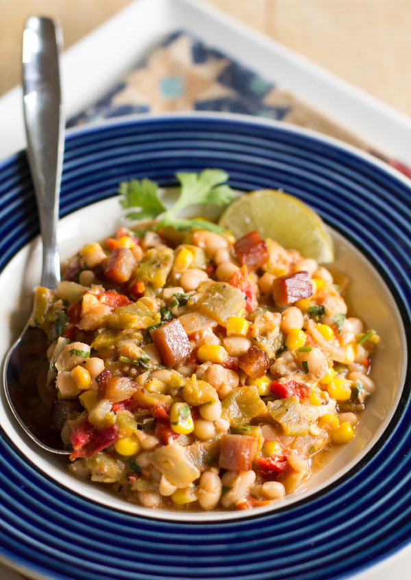 A hearty one pot meal with navy beans and green chile, corn, tomatoes and a host of other goodness. #green #chile #beans @mjskitchen