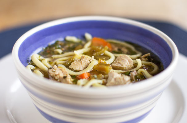 A hearty and healthy green chile chicken noodle soup with roasted garlic and homemade noodles #green #chile #soup #noodles mjskitchen.com