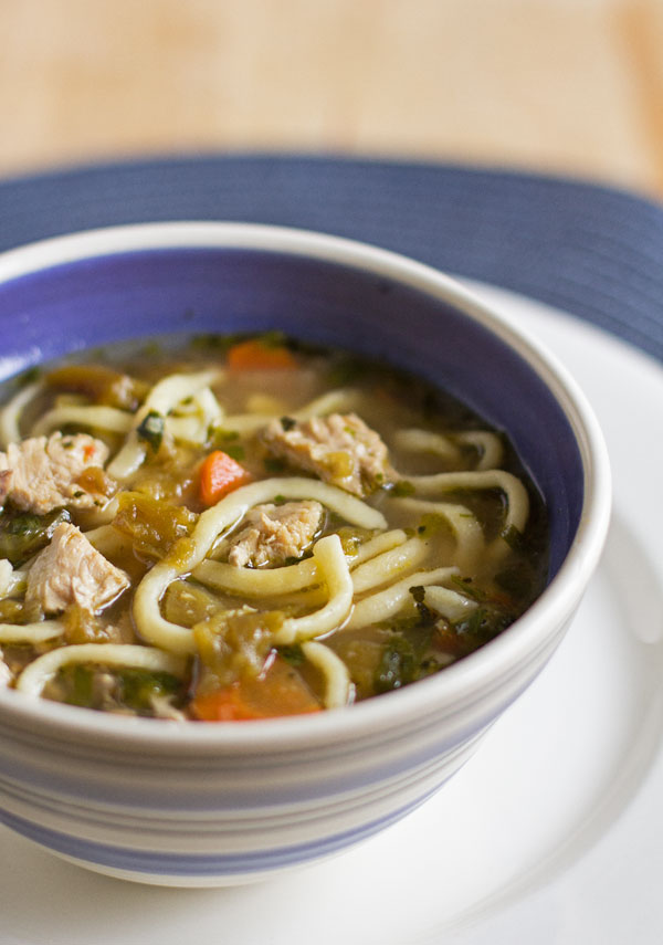 A hearty and healthy green chile chicken noodle soup with roasted garlic and homemade noodles #green #chile #soup #noodles @mjskitchen