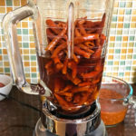After boiling, run the re-hydrated chile de arbol and some of the water through a blender. mjskitchen.com