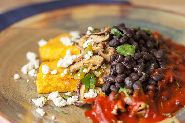 A hearty vegetarian meal with black beans, shiitake, fried polenta and feta topped with New Mexico red chile | mjskitchen.com