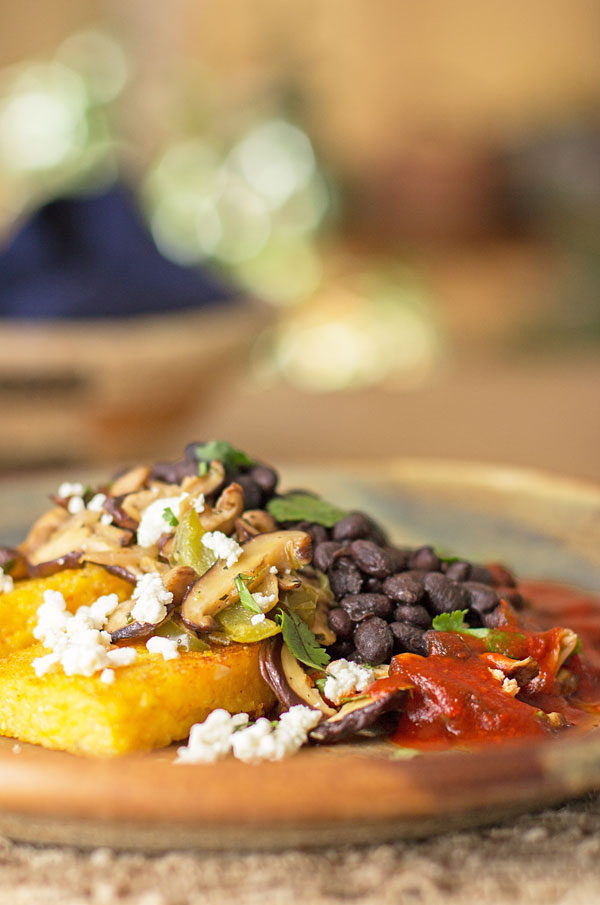 A hearty vegetarian meal with black beans, shiitake, fried polenta and feta topped with New Mexico red chile @redchile #shiitake #blackbean #vegetarian @mjskitchen