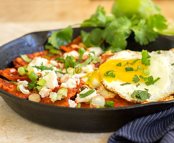 Red Chile Chilaquiles - An easy dish with corn tortillas, New Mexico red chile, an egg and topping of your choice. mjskitchen.com