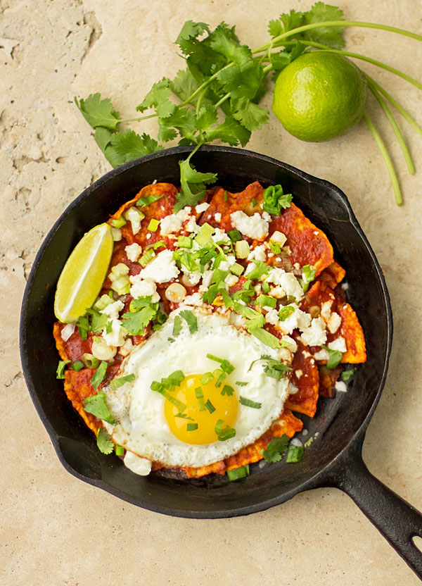 Red Chile Chilaquiles - An easy dish with corn tortillas, New Mexico red chile, an egg and topping of your choice. #chilaquiles #redchile @mjskitchen