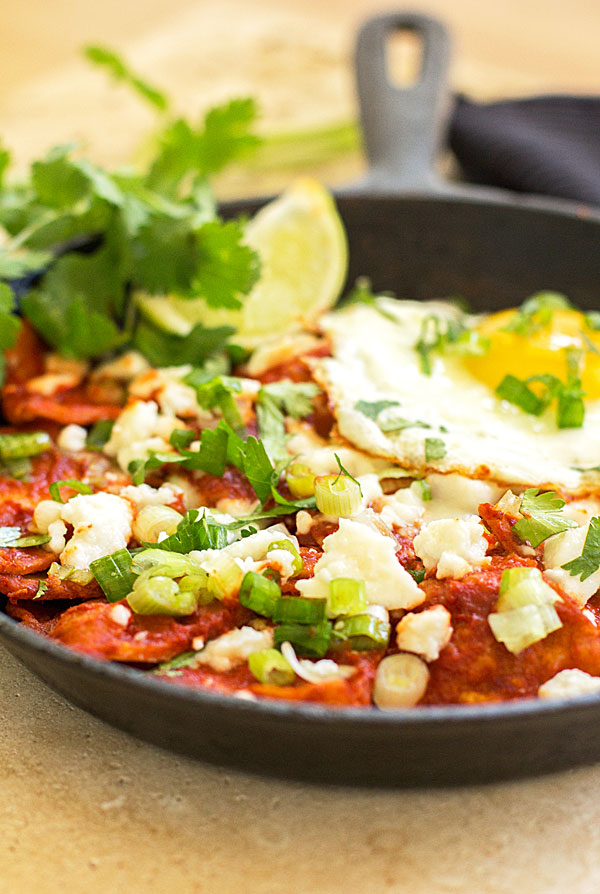 Red Chile Chilaquiles - An easy dish with corn tortillas, New Mexico red chile, an egg and topping of your choice. #redchile #chilaquiles @mjskitchen
