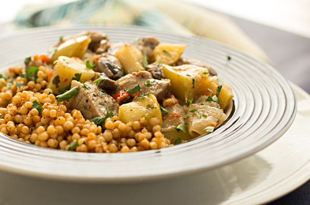 A quick and easy meal - Bourbon Braised Pork Loin with apples and mushrooms, served over Israeli couscous #pork #easy #meal |mjskitchen.com
