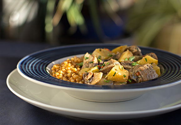 A quick and easy meal - Bourbon Braised Pork Loin with apples and mushrooms, served over Israeli couscous #pork #easy #meal | mjskitchen.com