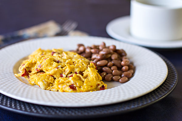 Our favorite Scrambled Eggs - Farm fresh eggs scrambled with roasted red chile and cotija cheese   mjskitchen.com
