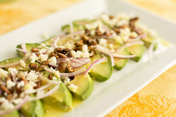 Avocado Onion Salad with sweet and spicy pepitas and cotija cheese. Serve as a starter or salad. | mjskitchen.com