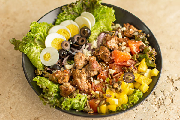 A composed salad with green chile sausage and a variety of healthy salad ingredients. | mjskitchen.com
